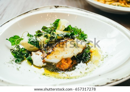 Barramundi stock images royalty free images vectors for Cooking white fish