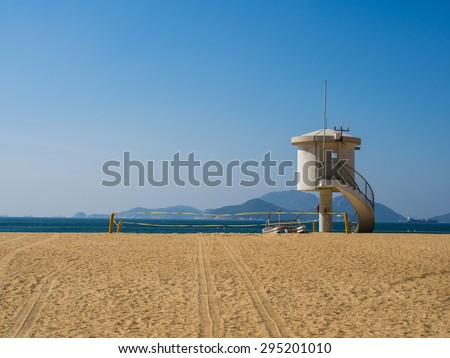 Seacoast beach and observation tower or lifeguard tower with blue sky in good weather day , Hongkong. - stock photo