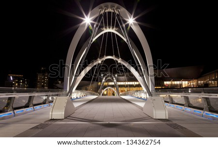 Seafarers Footbridge in front of The Bridge south Wharf in Melbourne, Victoria, Australia. - stock photo