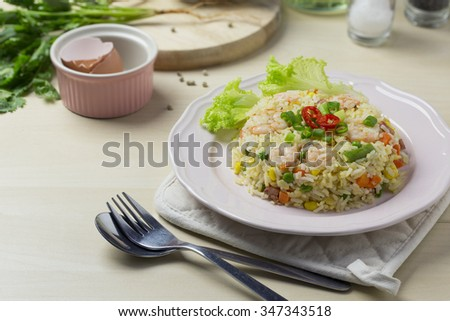 Seafood and egg fried rice on high key wooden table top. Closeup. - stock photo