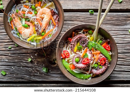 Seafood and fresh vegetables with noodles - stock photo