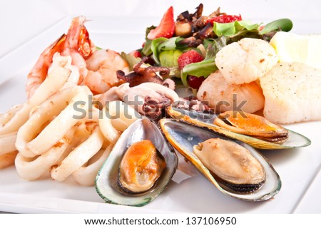 Seafood and salad - stock photo