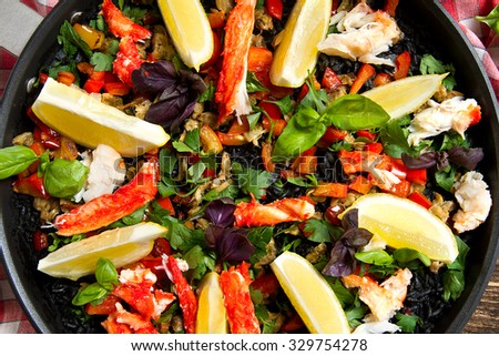Seafood and squid ink paella