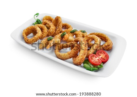 Seafood baked in the oven with breadcrumbs: Tiger prawns, squid, onion rings on the plate, isolated on white background - stock photo