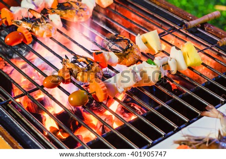 seafood barbecue grilled on roaster and fire
