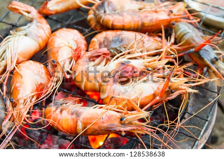 Seafood barbecue of grilled Shrimps on charcoal oven - stock photo