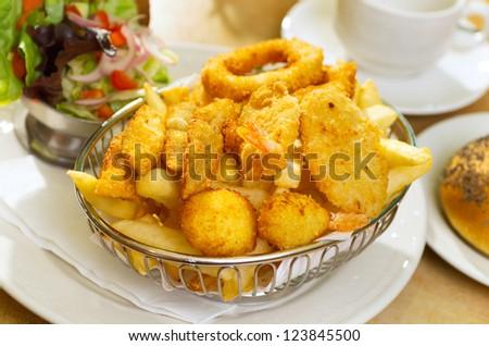 Seafood Basket with crumbed fish,calamari,scollop,prawn with potato chips - stock photo