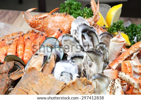 Seafood buffet (Oyster and Alaska King) Crab in hotel restaurant - stock photo