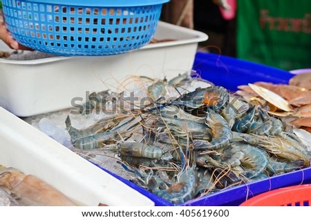 seafood for sale in the fresh market, fresh shrimps on  ice - stock photo