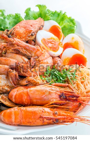 Seafood fried with spicy sauce and a Medium-boiled egg