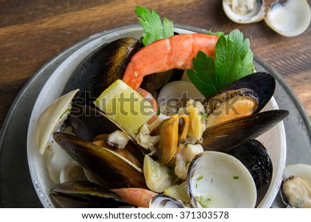Seafood in bowl on wooden table