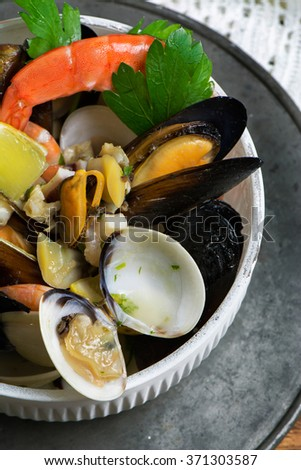 Seafood in bowl on wooden table From above