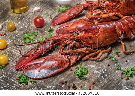 Seafood lobsters. Fresh beautiful large sea lobsters. Delicious lobster on a wooden table. - stock photo
