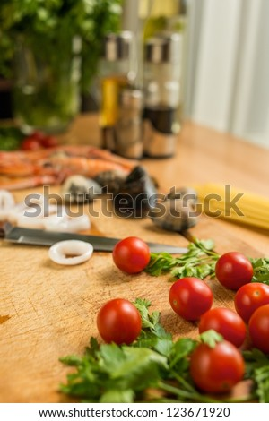 Seafood meal preparation process - stock photo