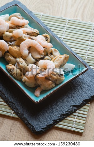 Seafood mix on platter with prawns squid and mussels - stock photo