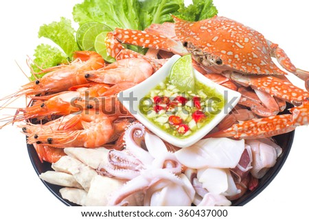 seafood mixed with spicy sauce thai food traditional isolated on white  - stock photo