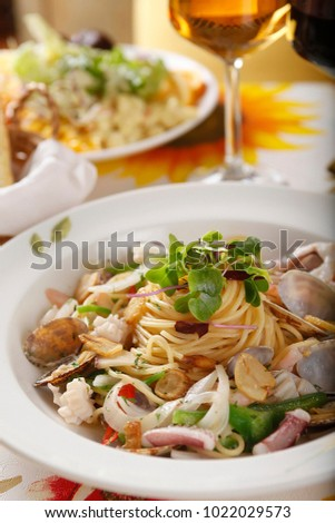 seafood oil pasta on the table