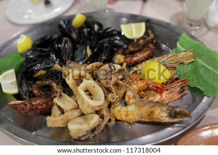 Seafood on a silver plate in a restaurant