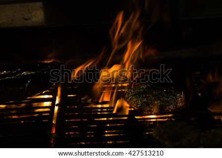 Seafood on grill  with flames of fire