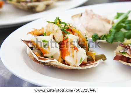 Seafood over white plate, close up, horizontal image