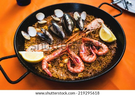 Seafood paella in traditional spanish restaurant in Barcelona