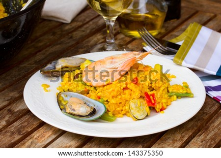 Seafood paella, traditional spanish dish  served in plate