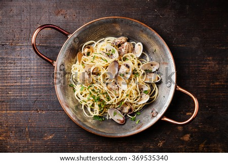 Seafood pasta with clams Spaghetti alle Vongole on wooden background - stock photo