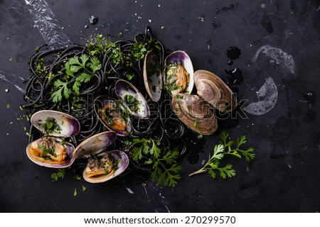 Seafood pasta with clams Spaghetti Vongole on dark marble background - stock photo