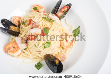 Seafood Pasta with mussels and basil for a tasty sea food meal macro - stock photo