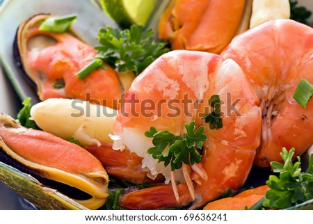 Seafood plate with shrimps and mussels - stock photo