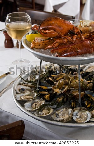 Seafood platter for two with wine - stock photo