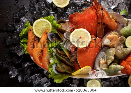 Seafood platter with ice on slate