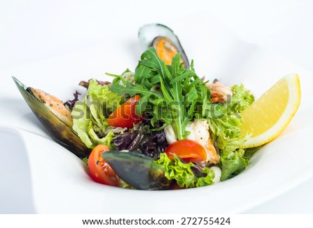 Seafood salad isolated on white - stock photo