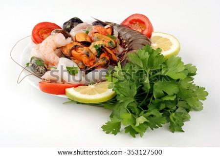 Seafood salad shellfish on white  - stock photo