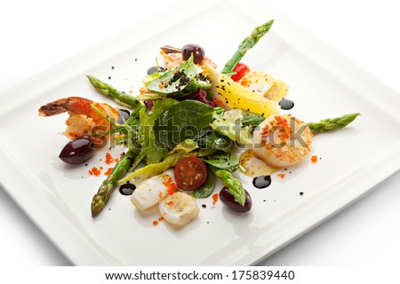 Seafood Salad with Asparagus, Lemon and Salad Mix - stock photo
