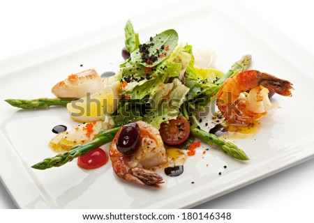 Seafood Salad with Asparagus, Lemon and Salad Mix - stock photo