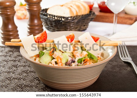 Seafood salad with parmegian and tomatoes