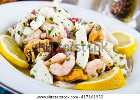 Seafood Salad with prawns, mussels, squids, octopus decorated with parsley