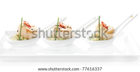 seafood scallop salad with a spoon - stock photo