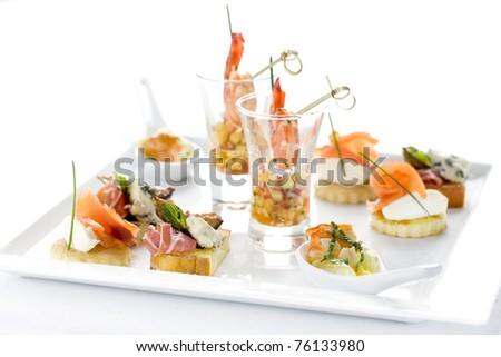 seafood selection, snacks, shrimp, salmon, bacon, eggs, butter restaurant - stock photo