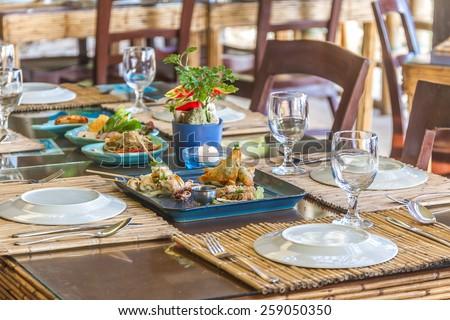 seafood snacks, calamaris, squid rings served in outdoor restaurant, asian cuisine - stock photo