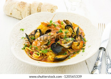 Seafood soup in the white plate