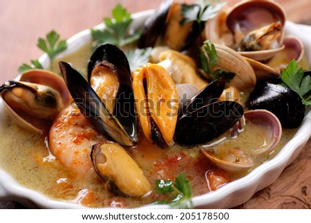 seafood soup in white bowl
