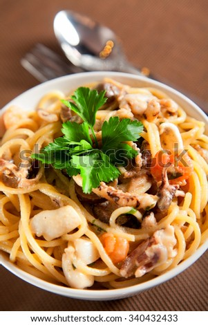 Seafood spaghetti with olives and cream