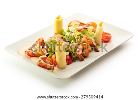 Seafood with Rigatoni Pasta and Mixed Salad - stock photo