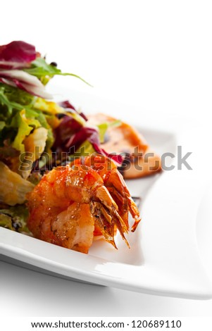 Seafoods - Shrimps, Sea Scallops, Squids and Salmon. Garnished with Fresh Raw Salad Leaf. - stock photo