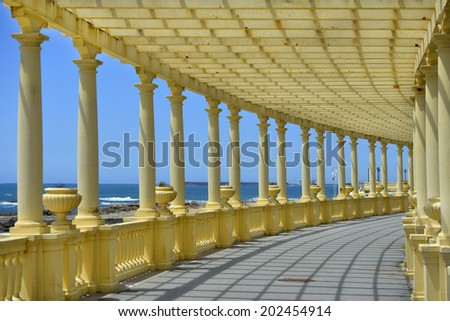 Seafront and architecture vintage colonnade in Porto coast, Portugal - stock photo