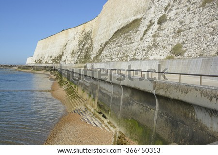 Seafront promenade under chalk cliffs between Brighton Marina and Rottingdean. East Sussex. England