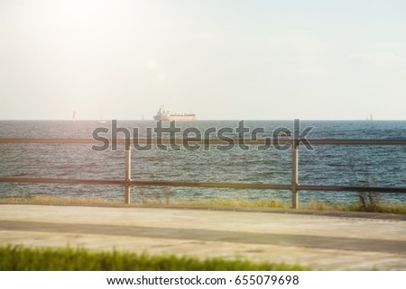 Seafront promenade with views of ships