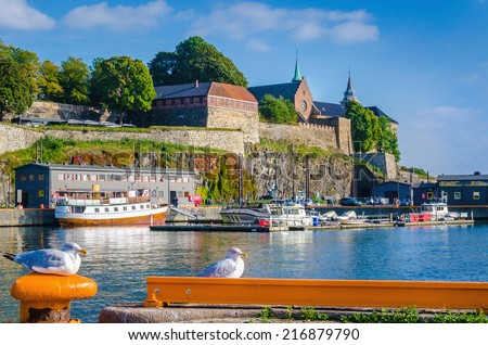 Seagulls in harbor in front of Akershus fortress, Oslo, Norway  - stock photo